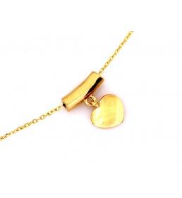 Złoty naszyjnik z wiszącym sercem celebrytka